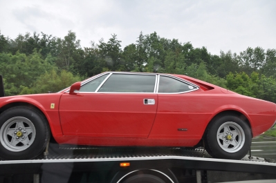 Just a Ferrari being towed (in the rain)
